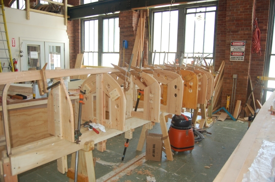 First the ribs of the boat are put in pace. Lots of clamps are used.