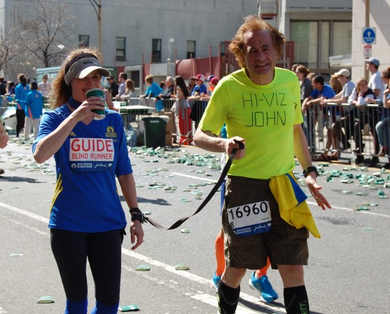A visually impaired runner and his guide