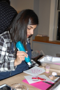 Rachna working the embossing gun